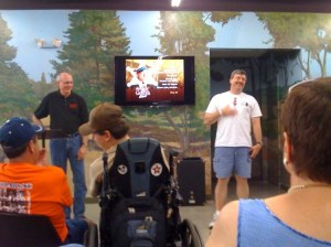 """Neal Brower (standing, left) enjoys watching Allan Newsome do an impromtu Floyd for the audience gathered at in basement theater at the Andy Griffith Museum for Neal's lecture on the """"Back to Nature"""" episode on July 12. Photo courtesy of Terry Mayew (Barney chapter)."""
