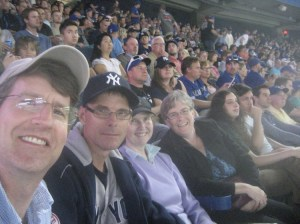 GOOBER SAYS EH!--A selfie Goober with Canadian Yankees fan Albert Cooper, Albuquerque Isotopes fan Mary Clar, and Blue Jays fan Beth Cooper at the ol' ball game in Toronto.