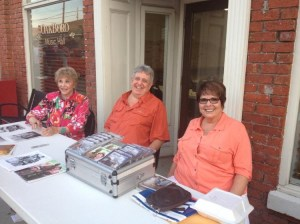 Maggie Peterson (left) with Rodney and Beverly Dillard at the Cruise-In in Oakboro, N.C., part of the DARE fundraiser weekend.  Photo by Tom Rusk.