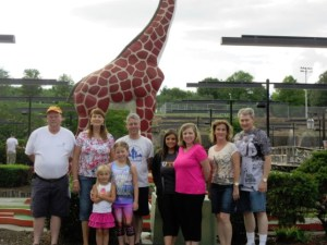 BOY, GIRAFFES ARE....HEADLESS--Ichabod the giraffe serves as a backdrop when Mayberry chapter got together for the fun of it in June for miniature golf.