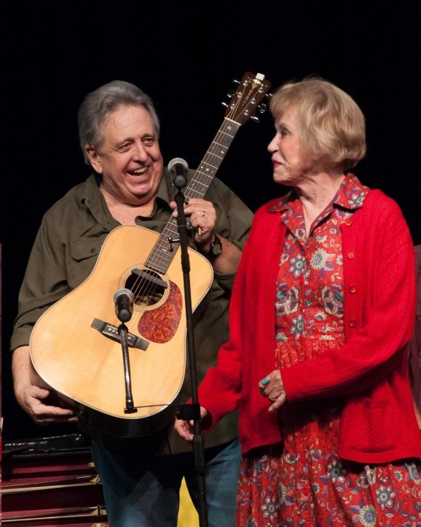 DARLING PAIR--Rodney Dillard and Maggie Peterson sharing a good time with the audience during their Saturday Mayberry Days show. Photo by Kenny Hooker.