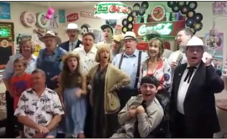 "Karen Knotts (between Otis and Mayor Pike) sings the ""Mayberry Union High"" song with a gaggle of tribute artists and others at Mayberry Comes to Westminster."