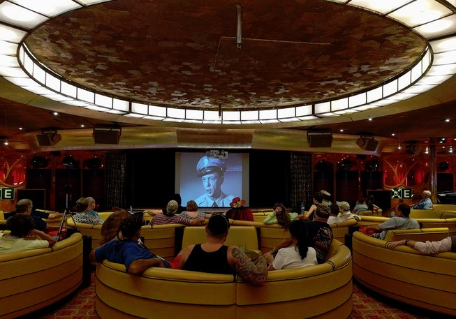 TIME TO WATCH AT SEA--Mayberry Cruise participants relax and enjoy an episode of TAGS while floating across the Caribbean.