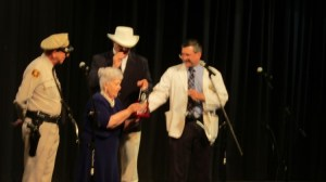 "BEE PROUD--Allan Newsome presents the ""You're the Cat's!"" Awards to Alma Venable as Keith Brown (Col. Harvey) and David""Mayberry Deputy"" Browning (the 2015 recipient) look on. Alma and other tribute artists had just completed a Colonel Tim's Talent sketch recreating the scene from ""Aunt Bee's Medicine Man"" where a tipsy Aunt Bee sings ""Toot-Toot Tootsie."""