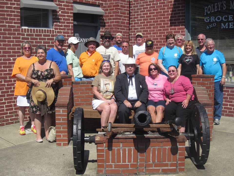 """BLOOEY--Members of """"Only One Word I Can Think of...Big"""" (Mint Hill, N.C.) pose by a local cannon for their annual Mayberry Days group picture."""
