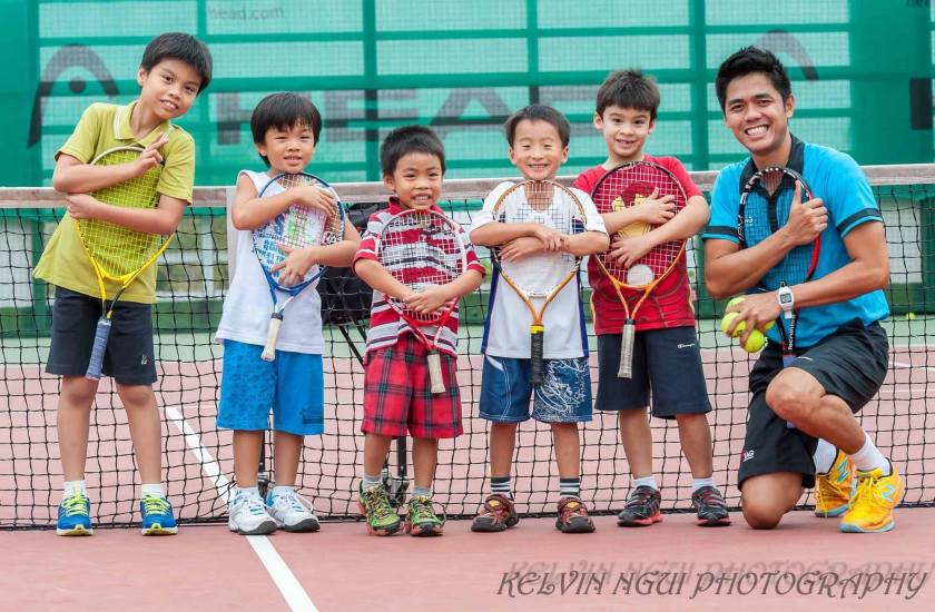 The Best Group Tennis Lessons in Singapore East at Chinese Swimming Club with Coach Rocky Paglalunan of TAG International Tennis Academy. Here, assistant director TAG Coach Michael Mantua takes a nice photo with his Junior Tennis Players.