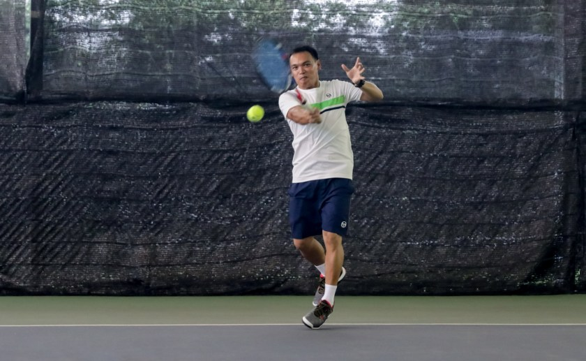 Tennis Coach Ray in action
