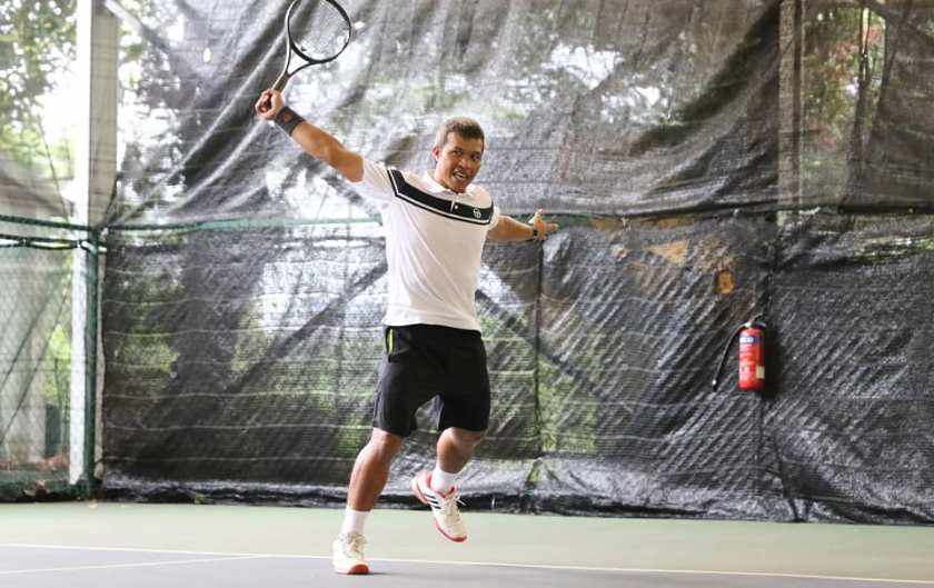 TAG International Tennis Academy's Coach Peter executes a beautiful backhand return of serve on the Deuce Court