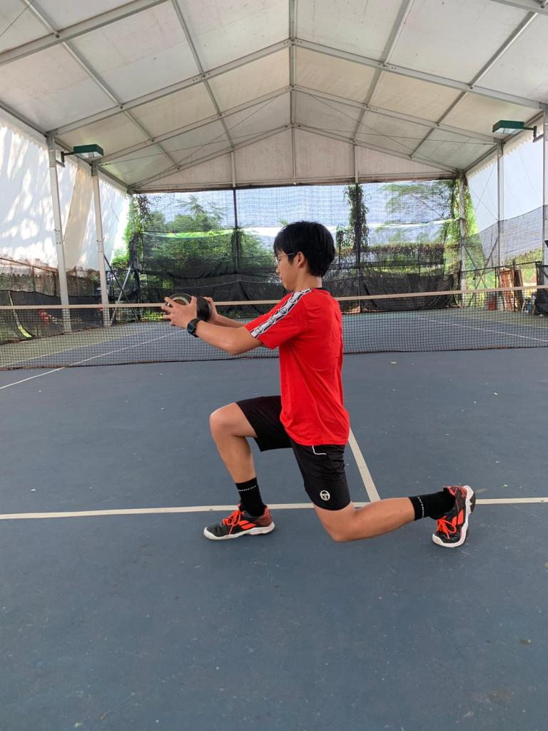 Aaron Chiu does single lunges for physical conditioning