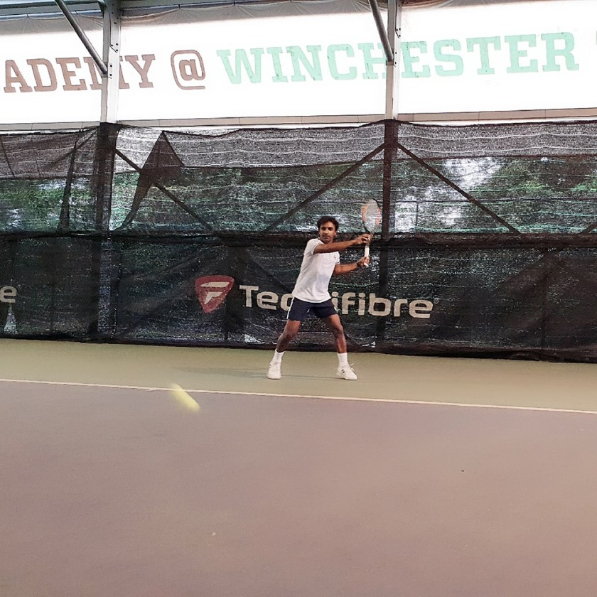 Coach Pratim sets up for a forehand topspin lob like a regular forehand