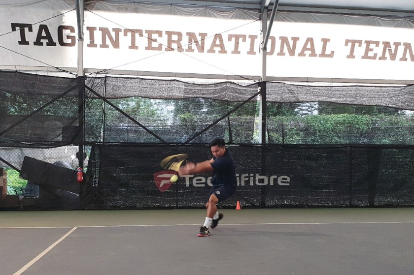 Coach Dave comes under the ball fast to impart wicked backspin on the backhand slice