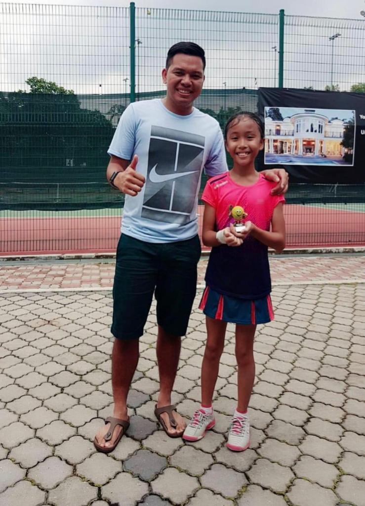 Coach Dave Regencia and Under 10 Champion Sarah Sofian Haidi