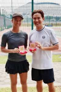 Claire Chan winning Champion with TAG Tennis Academy Head Coach XT