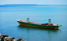 Traditional fishing boat. Long Boat. Pasighe Island in the background