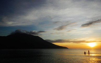 Sunset view of Ruang Island from the main beach in Bahoi. Tagulandang Island, Sitaro, Sulawesi Utara.