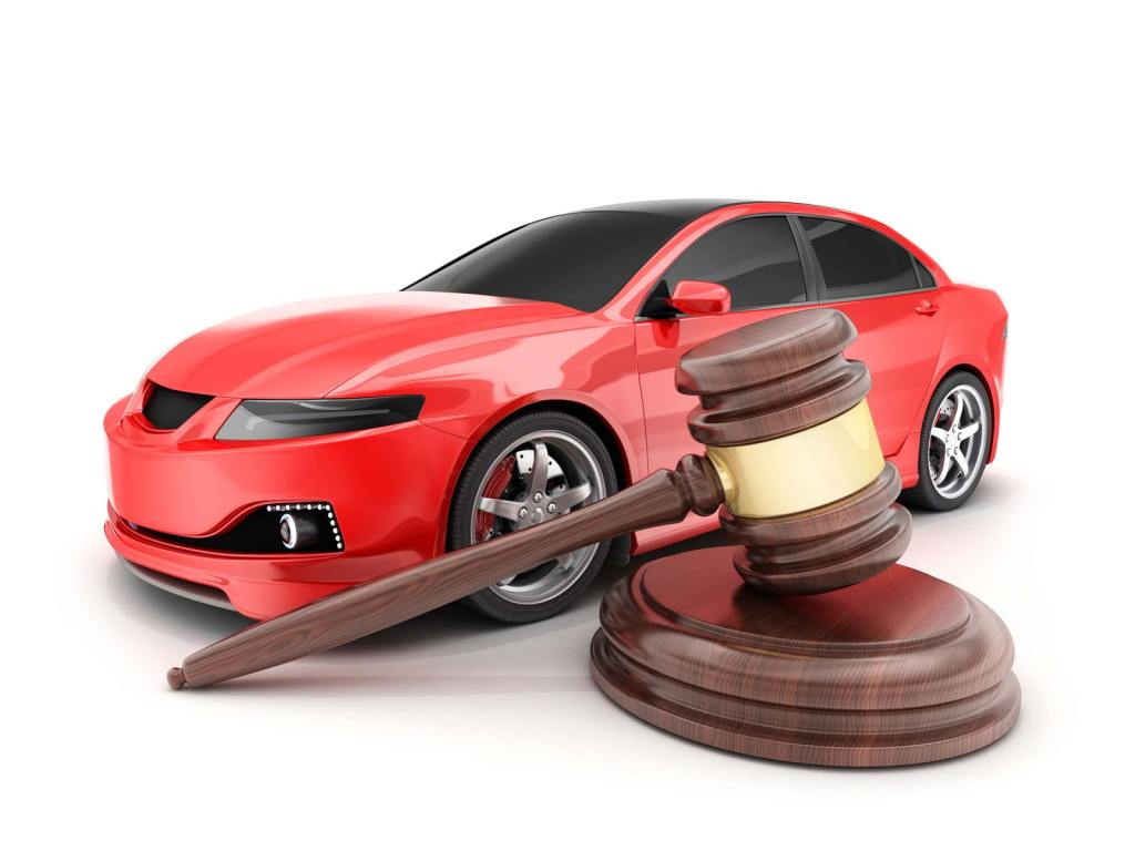 Giant gavel and hammer in front of a red car