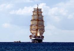 Square-rigged cruiseship sails away