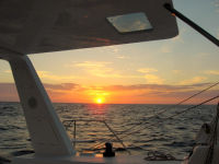 Beautiful golden sunset from a sailboat 25 miles off the Florida coast.