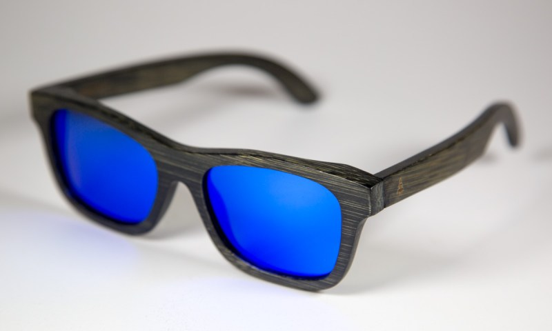 Side view of the Zephyr sunglasses. These frames are constructed with bamboo and feature a pair of blue, polarized lenses.