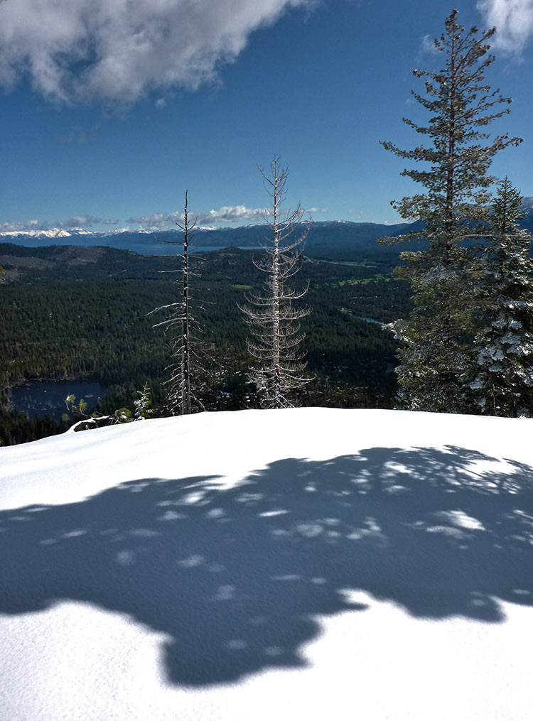 You can see Lake Tahoe from the bald hill beyond the bridge over Lower Echo Lake's outflow. Don't get close to the edge because this is avalanche territory. And definitely don't travel here when there is heavy snow as they will most likely be performing avalanche blasting. © Jared Manninen