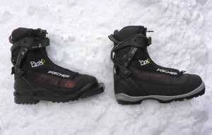 Fischer BCX 6 (3-Pin version) and Fischer BCX 6 (NNN BC version). Both of these rugged boots are designed in a similar fashion and used for heavier-duty backcountry cross-country skiing. However, I find that the 3-pin version does provide more control on wider cross-country skis because the 3-pin system is just a more rugged binding than NNN BC. I use the 3-pin on a set of 112 mm cross-country skis and the NNN BC on a set of 88 mm cross-country skis. © Jared Manninen