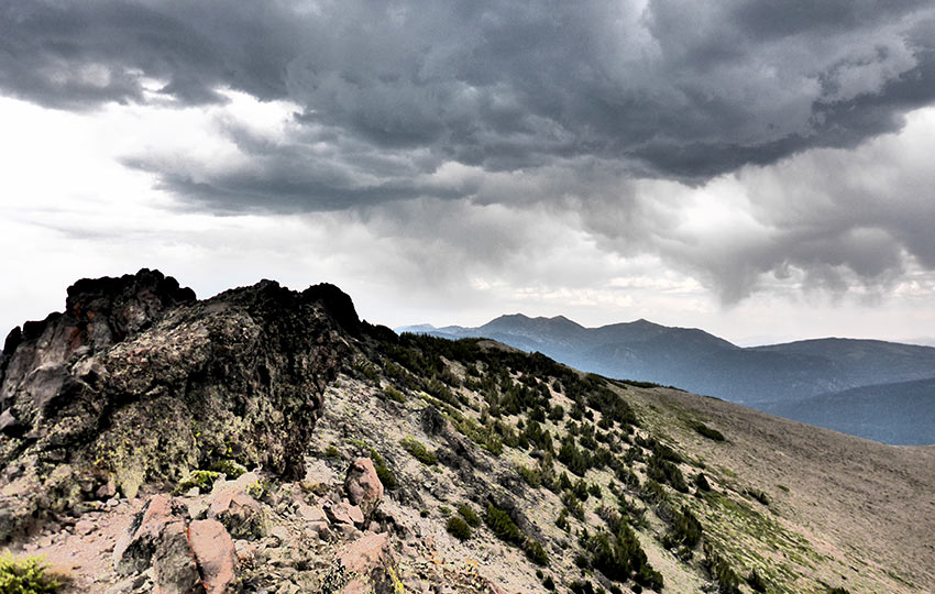 Ominous storm clouds hover over Red Lake Peak