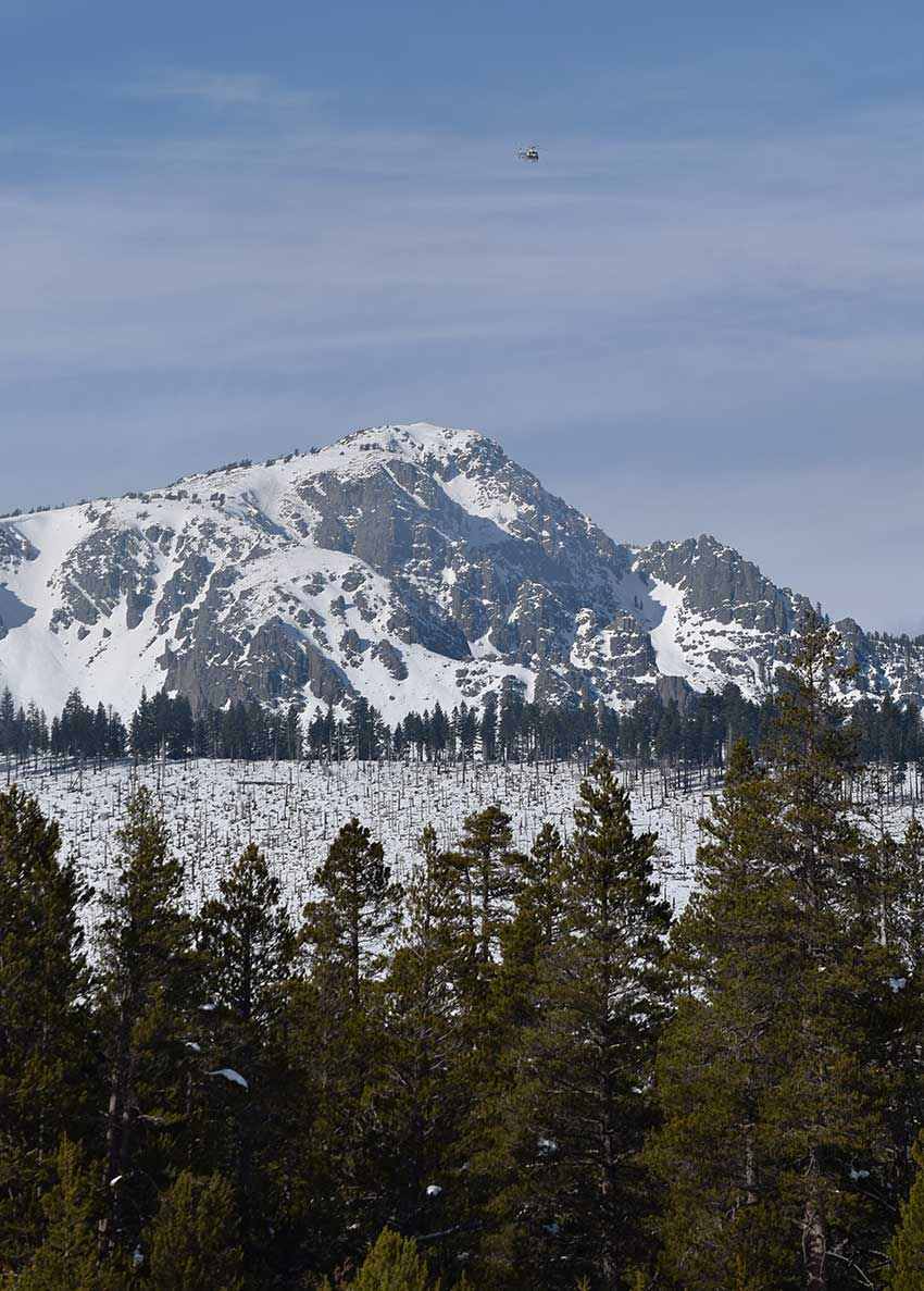 Mount Tallac with helicopter flying in the sky
