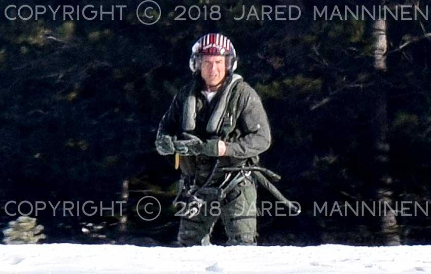 Tom Cruise staring back at the camera while filming Top Gun: Maverick