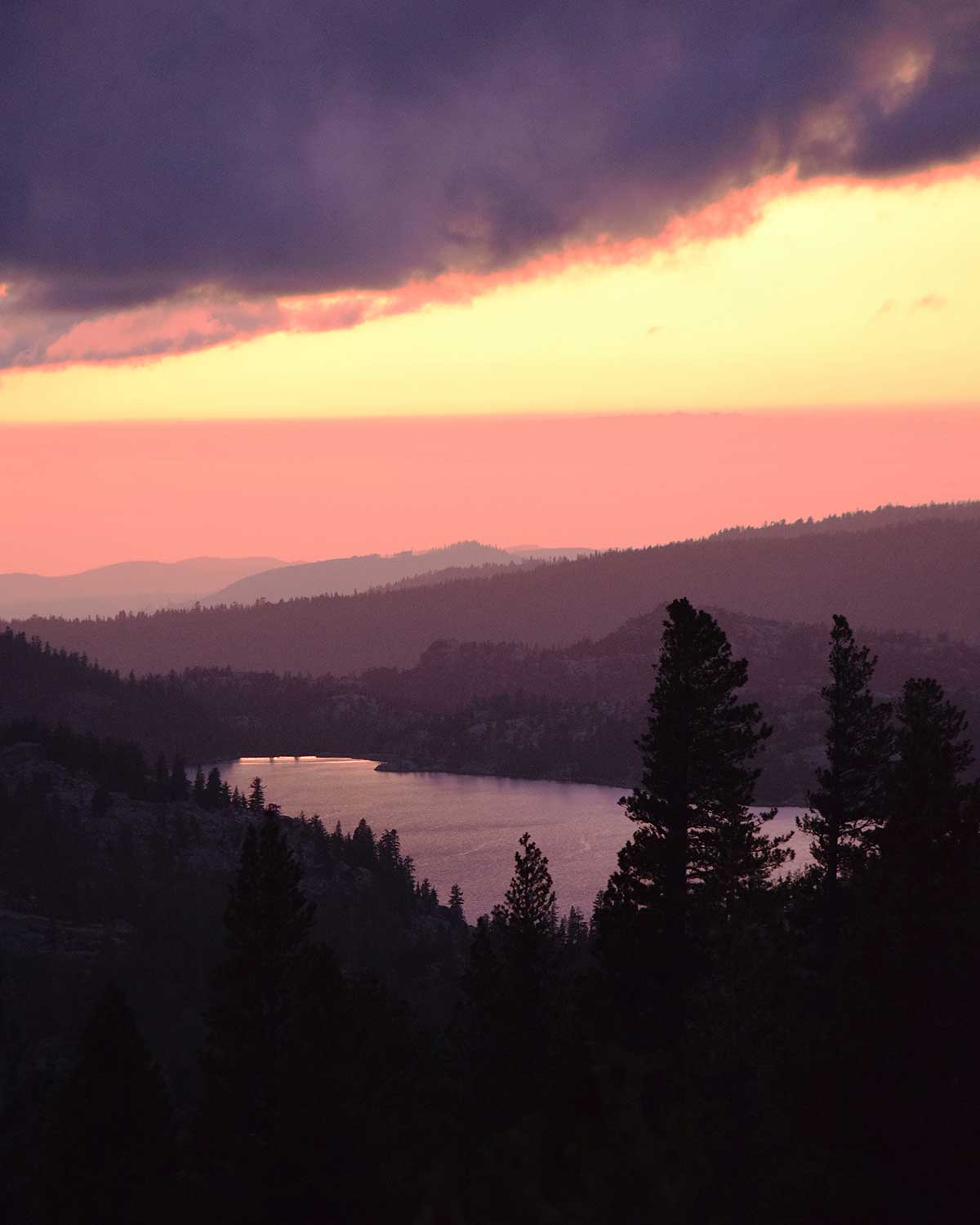 Caples Lake during a purple and gold clouded sunset