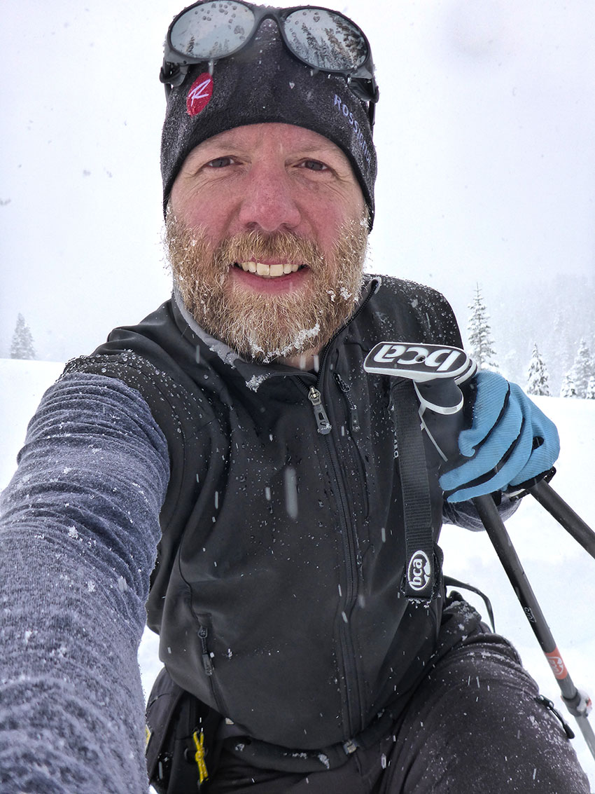 Man taking a selfie while cross-country skiing in a snowstorm