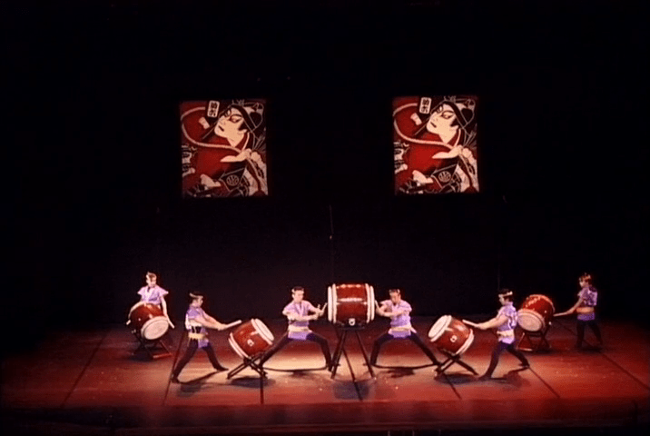 "Members of Oedo Sukeroku Taiko playing ""Yodan Uchi."" Screenshot from the 2004 DVD 'Les Tambours de Tokyo LIVE,' published by Sunset France."