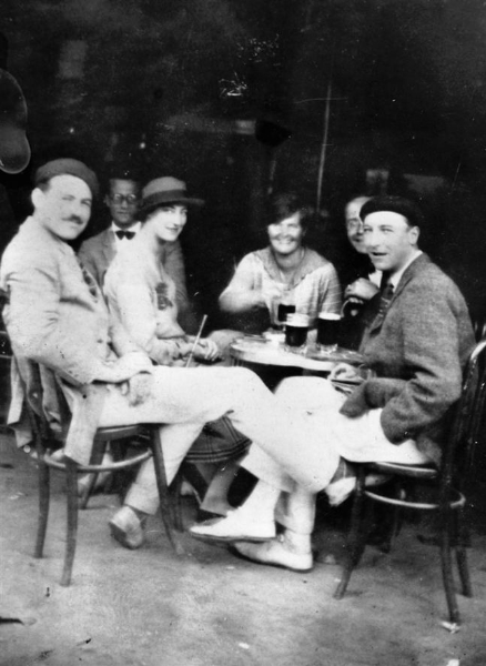 Hemingway and friends enjoying a cafe in Spain.