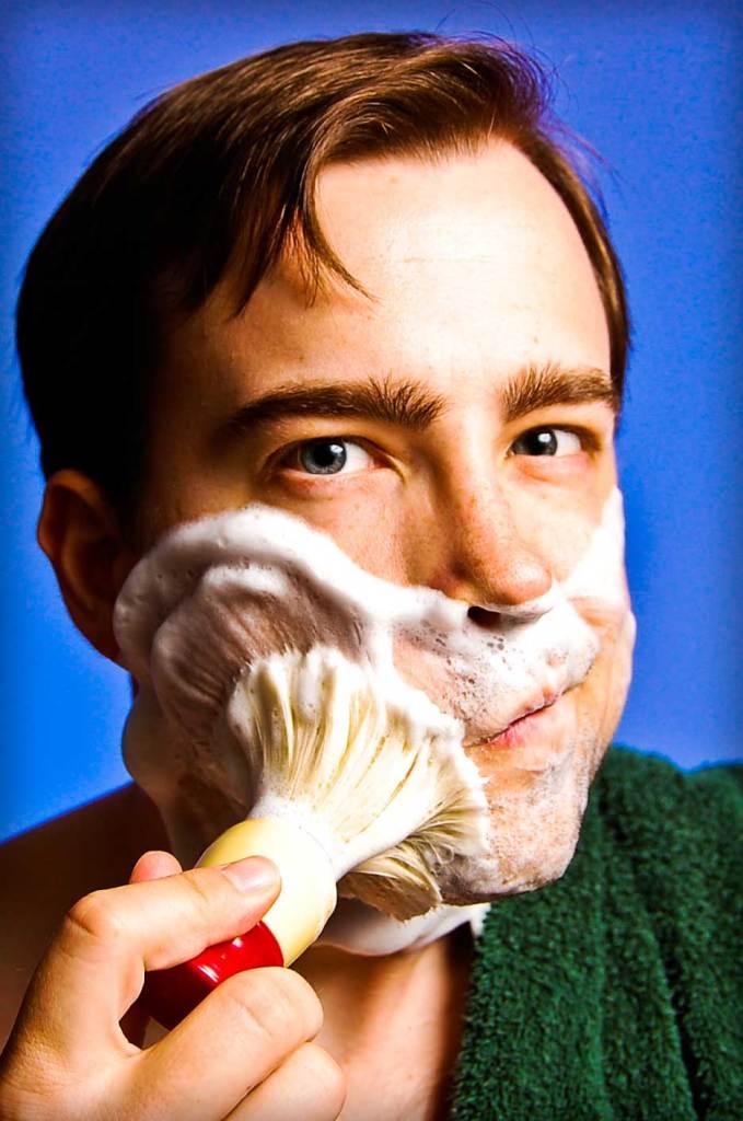 A man lathering shaving cream