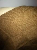 Lap blanket, closeup of stitch pattern and border.