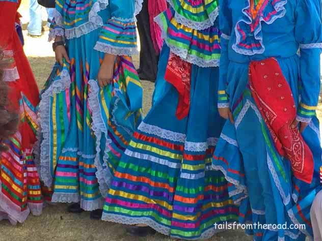Dancing girls with beautiful dresses.