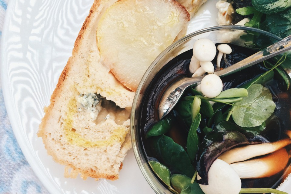 Raw mushrooms and herbs with a rich and earthy mushroom broth