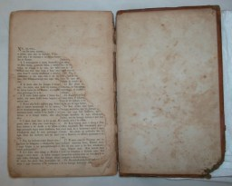 torn back page before conservation treatment