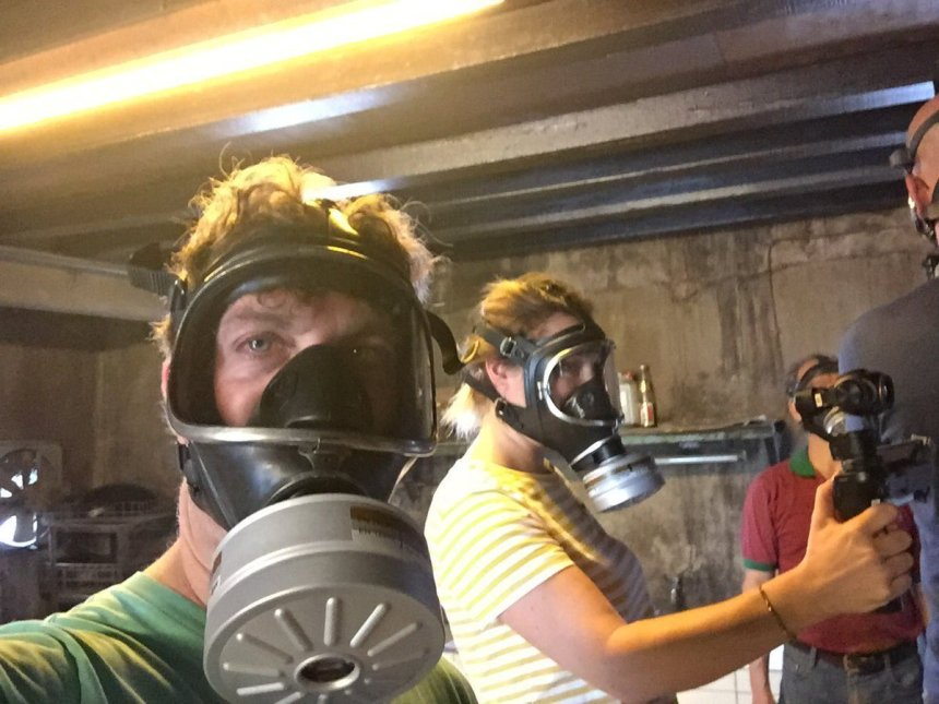 "Netflix Series ""Street Food"" Uncle Goat-Author and Film crew with Gas Masks."