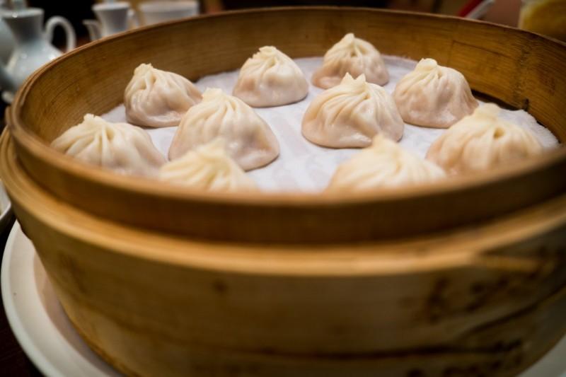 Xiao long bao (Soup dumplings) served in bamboo steamer.