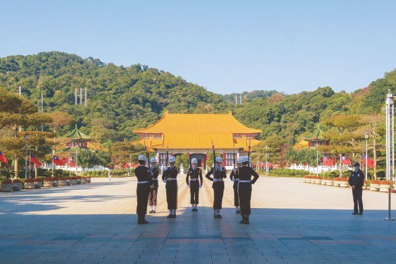 At the National Revolutionary Martyrs' Shrine in Taipei, you can witness the changing of the guard on the hour.