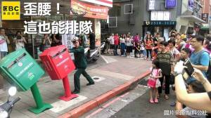 Taipei residents line up to take pictures of some cute mailboxes that have bent over after Typhoon Soudelor caused massive destruction on the island August 7-8, 2015