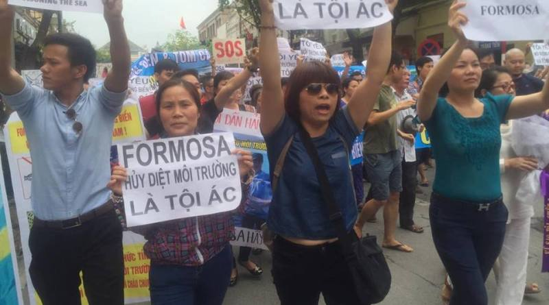 protesters hold banners condemning Formosa Plastics Group