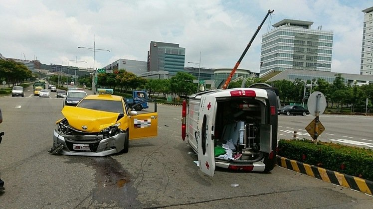 a taxi and ambulance after an accident in Taichung, Taiwan, 2016