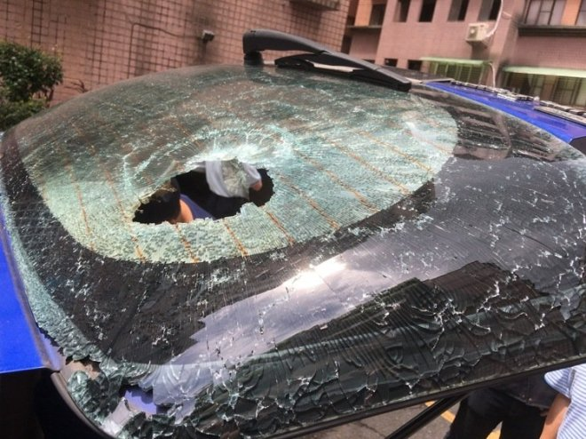 car with hole in window caused by flare