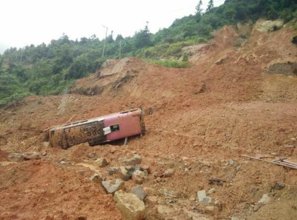 bus hit by landslide