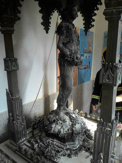 The scorched statue of the Virgin Mary after a fire August 3, 2016