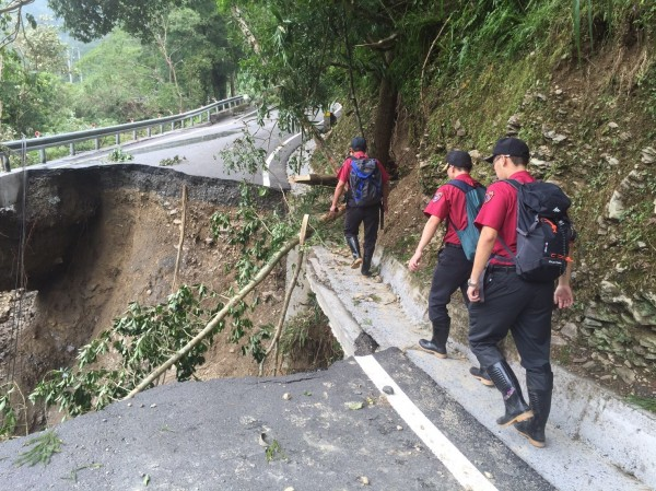 Rescue workers on the edge of a precipice