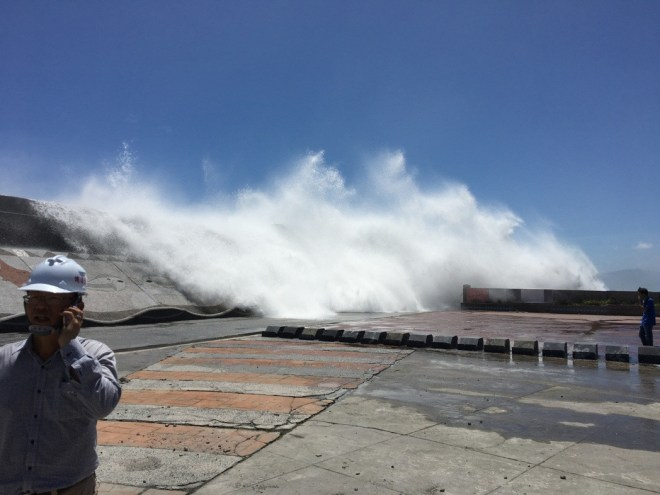 waves crash over a sea-wall in Hualien