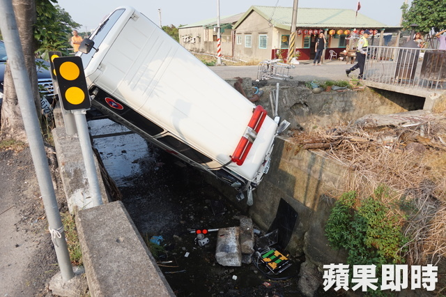 An ambulance in a ditch after being hitting a police car at high speed in Chiayi County Taiwan, November 6, 2016
