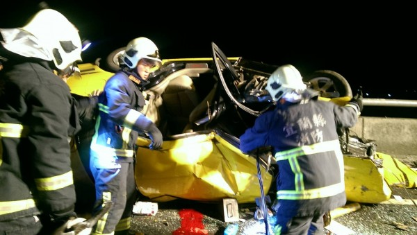 Firefighters use hydraulic cutters to extricate the victims of a car accident in Ilan County Taiwan May 9 2017